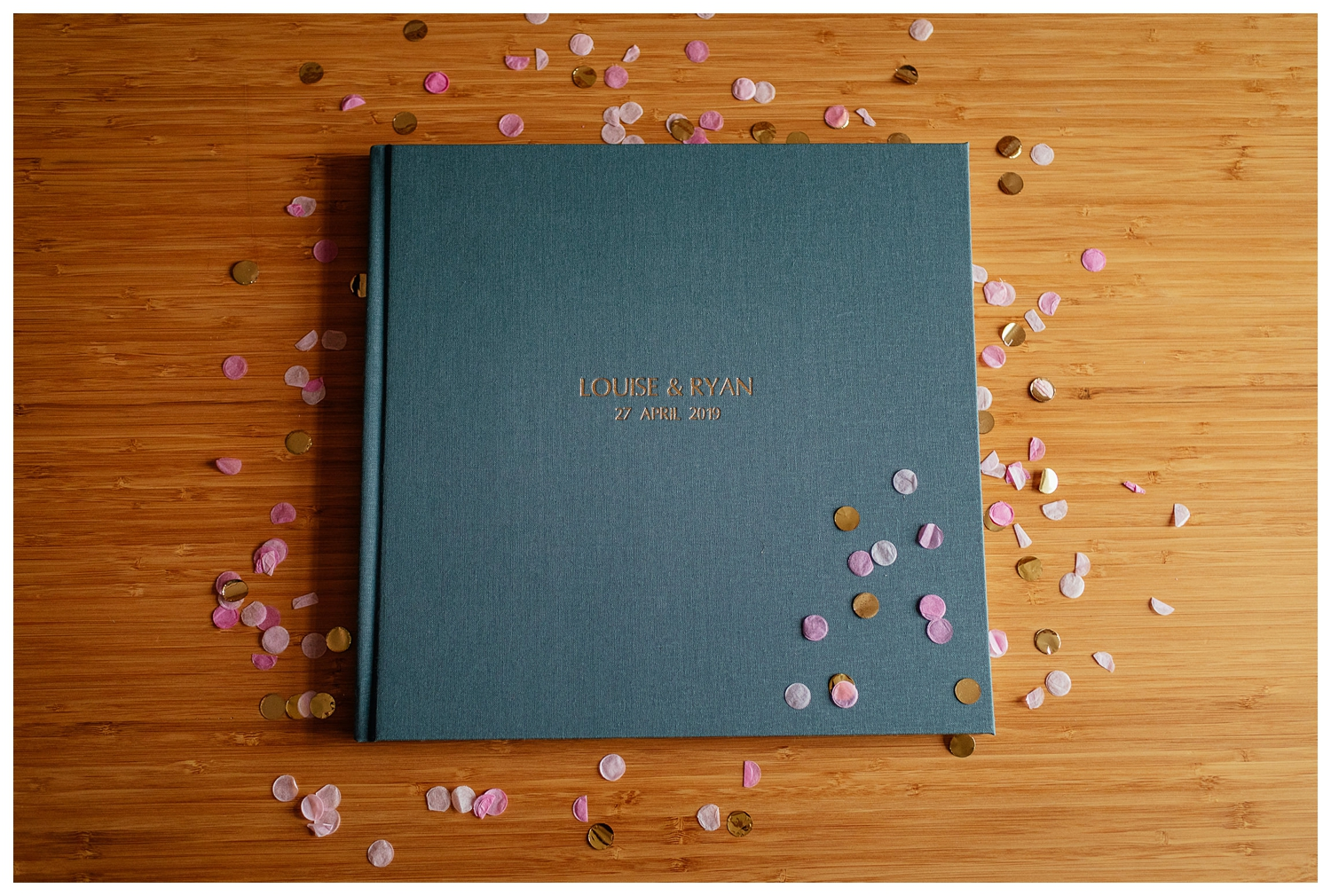 lay flat coffee table wedding album photo book linen cover example by Fotomaki Photography