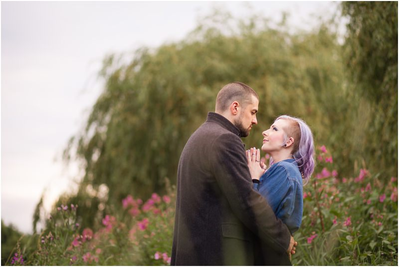outdoor couples engagement shoot session green trees purple hair