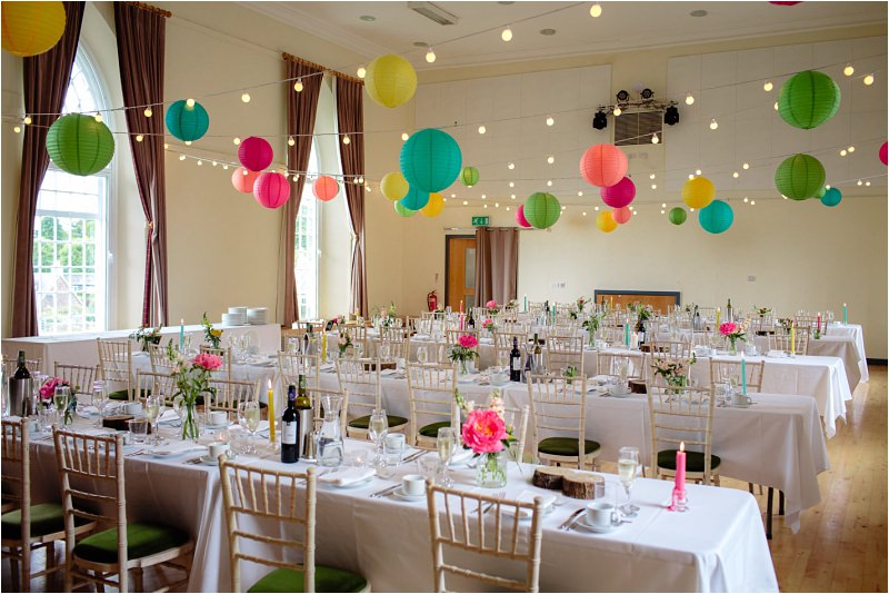 three sisters bake killearn village hall wedding set up for meal bright coloured lanterns