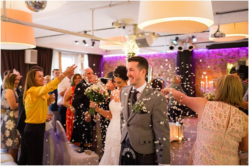 Bride & Groom walking through confetti after wedding ceremony at 29 Private Members Club, Glasgow