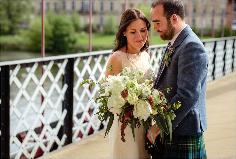Bride & groom on Portland Street Suspension Bridge with Bouquet