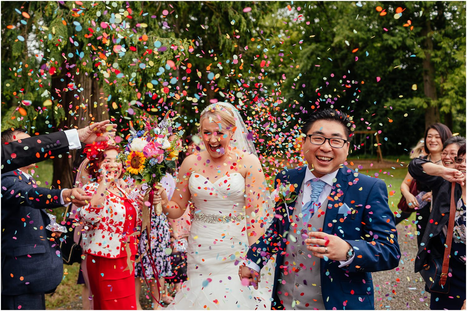 Cornhill Castle Wedding Colourful Confetti Photo Chinese Scottish Wedding Couple