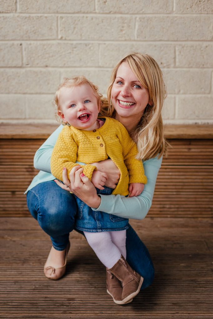 family photoshoot in barn pollok park glasgow young girl child and mum laughing