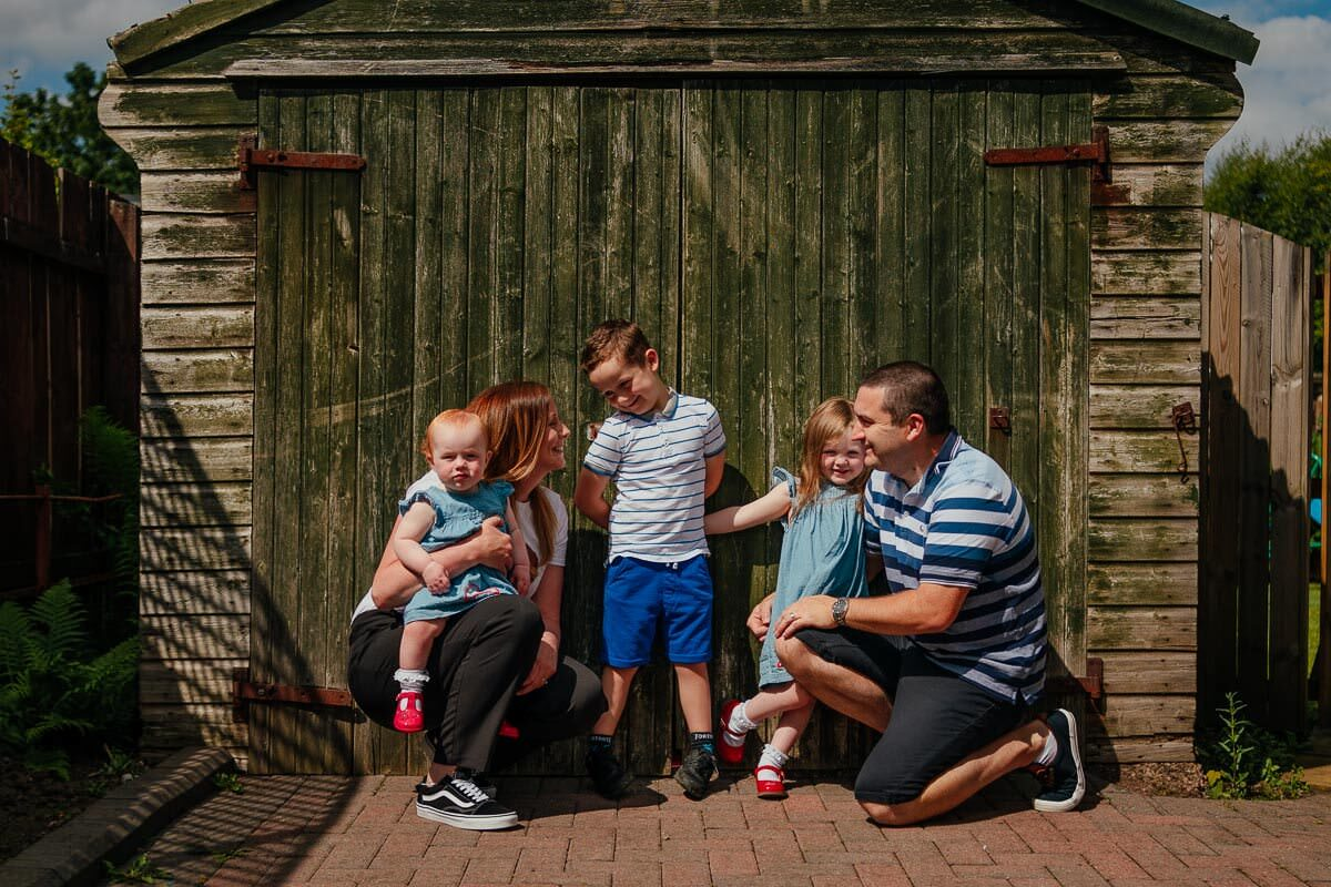 glasgow family photoshoot at home outdoors family in front of garage