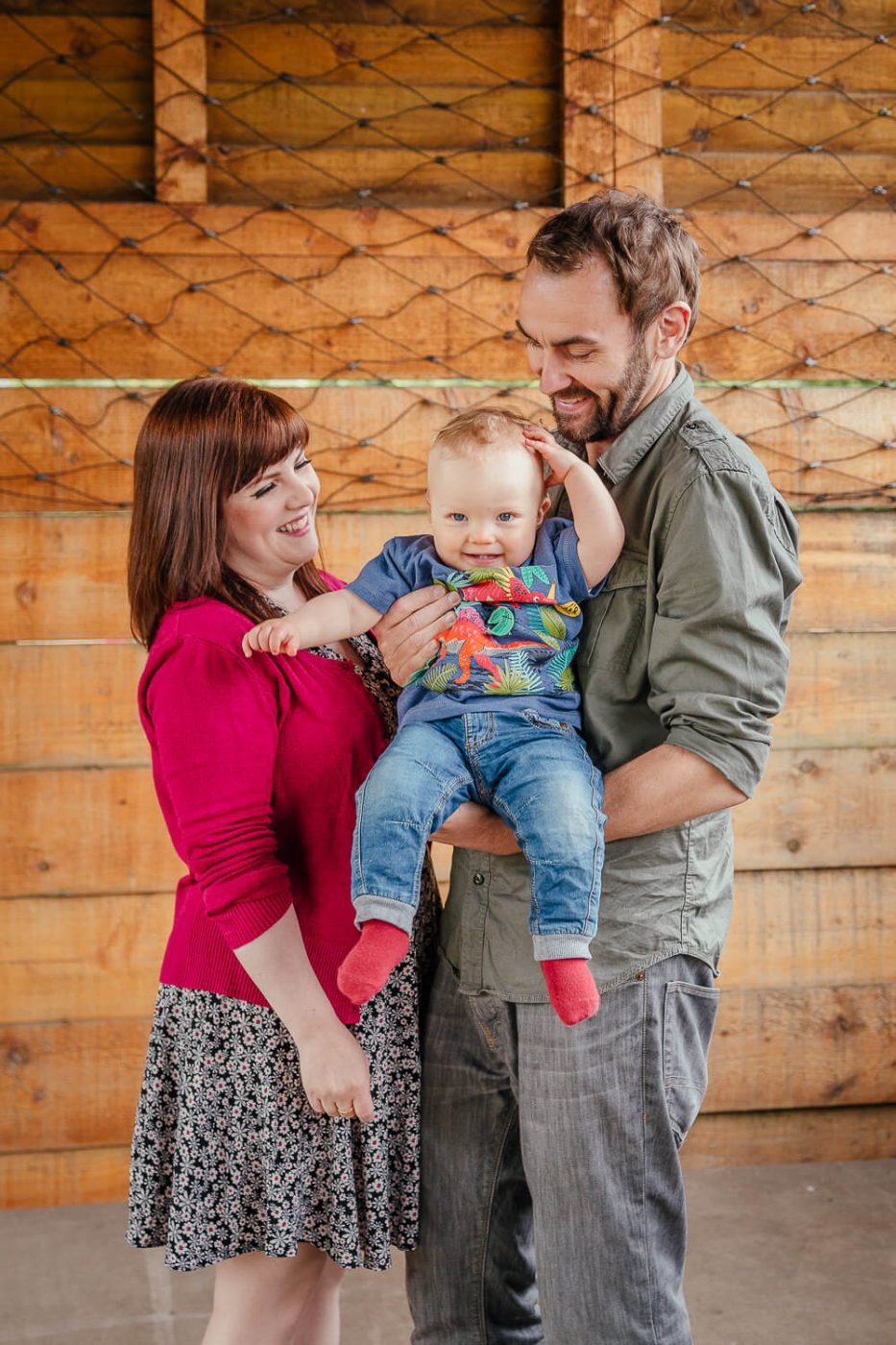 family photoshoot in barn Glasgow mum dad toddler smiling