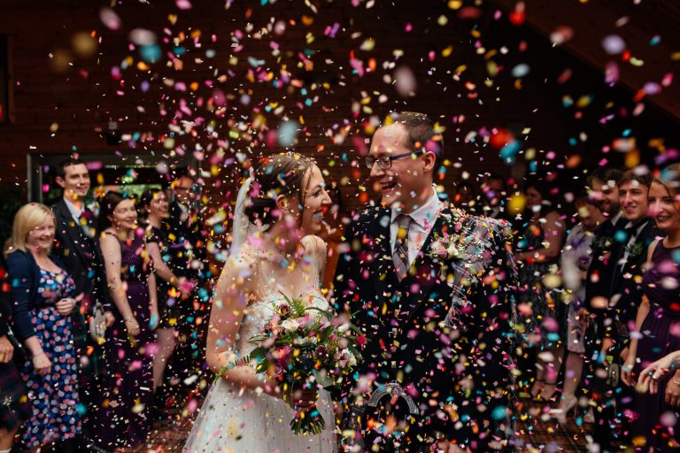 bride groom the cruin loch lomond just married colourful confetti throw