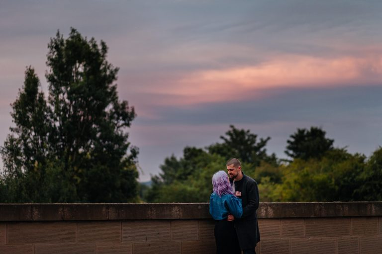 couples photos at sunset golden hour purple sky with purple haired girl
