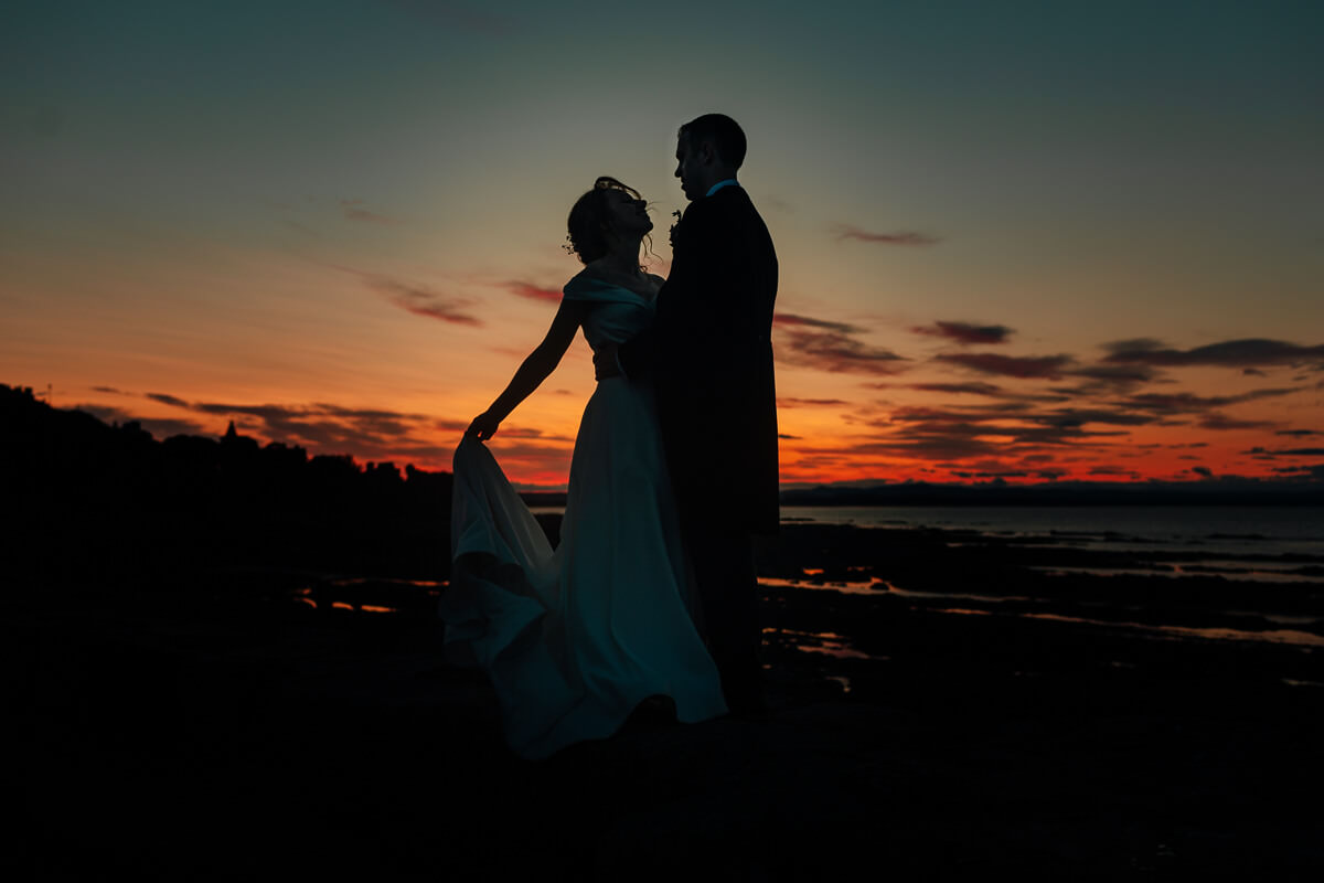 bride groom portraits in golden hour sunset beach harbour st andrews scotland