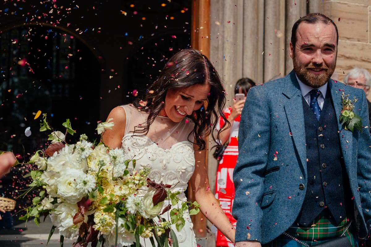 bride groom leaving church confetti throw glasgow st andrews cathedral