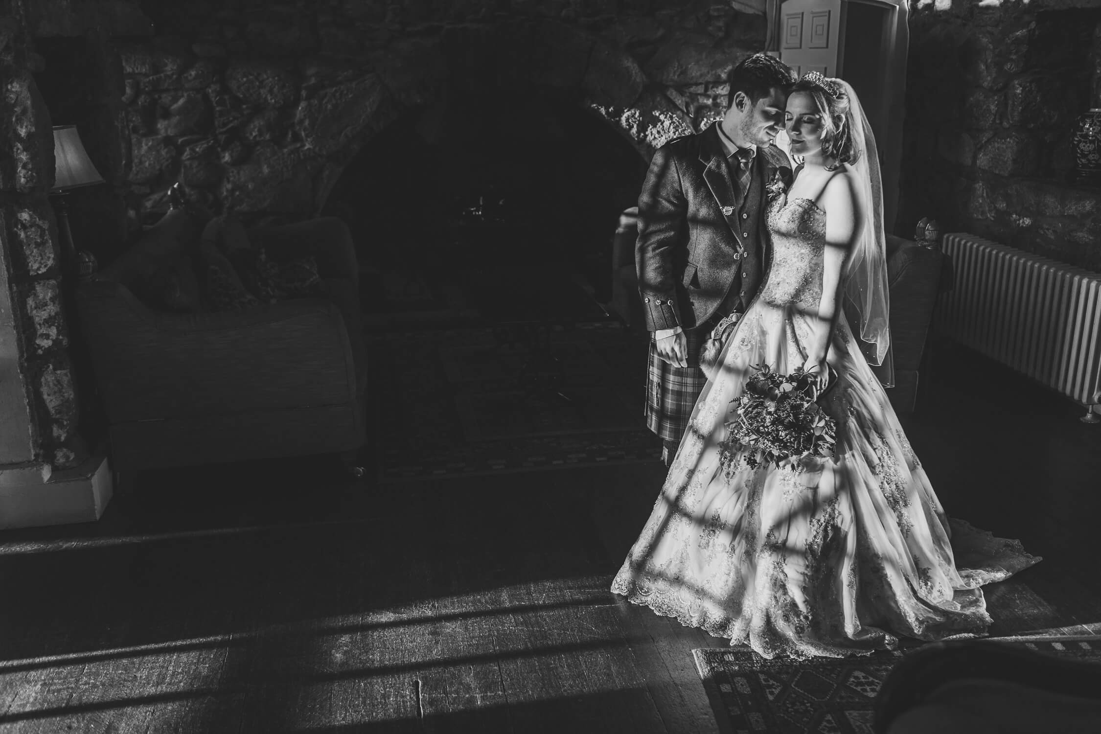 bride groom portraits in golden hour lines and shadows black and white at maryculter house hotel aberdeen