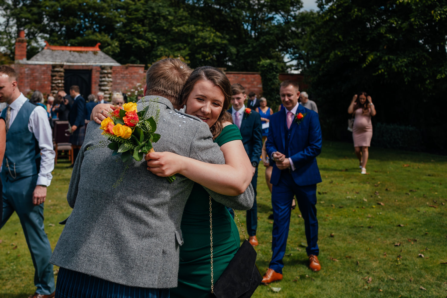 Ayrshire Wedding Piersland House Troon Outdoor Candid Bridesmaid Hugging