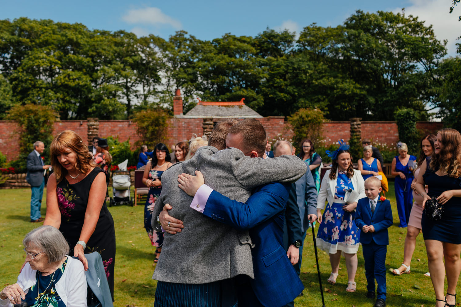 Ayrshire Wedding Piersland House Troon Outdoor Candid Friend Hugging