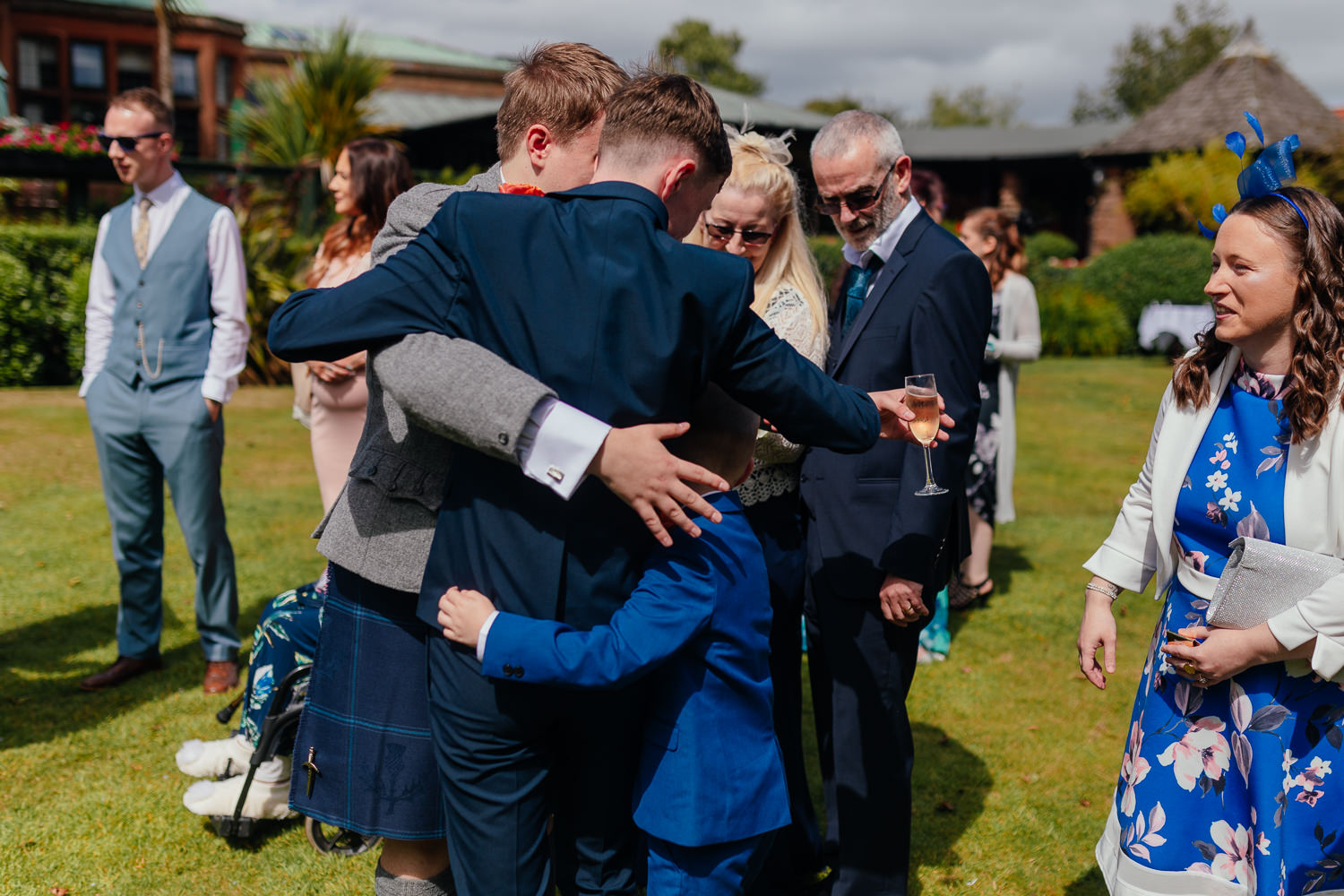 Ayrshire Wedding Piersland House Troon Outdoor Candid Family Hugging