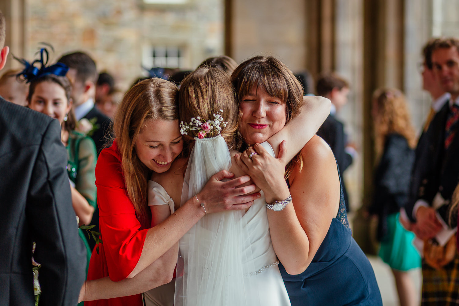 St Andrews Wedding Photos St Salvators Chapel Wedding Ceremony Candids Friends Hugging