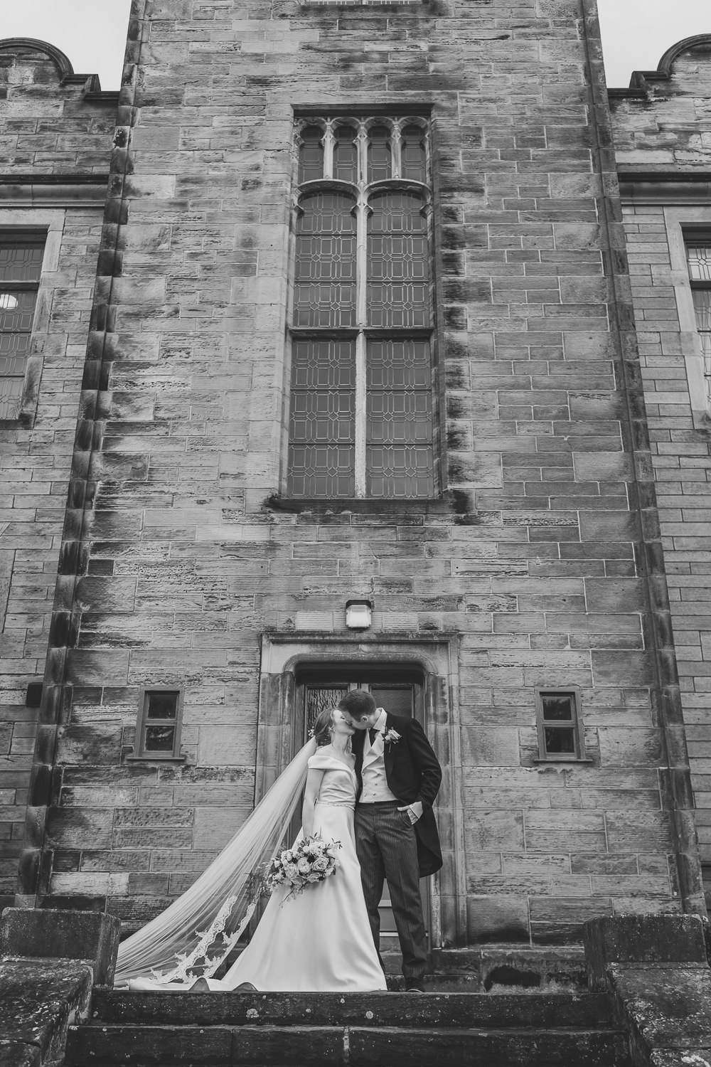 St Andrews Wedding St Salvators Hall Portraits Bride Groom Kissing