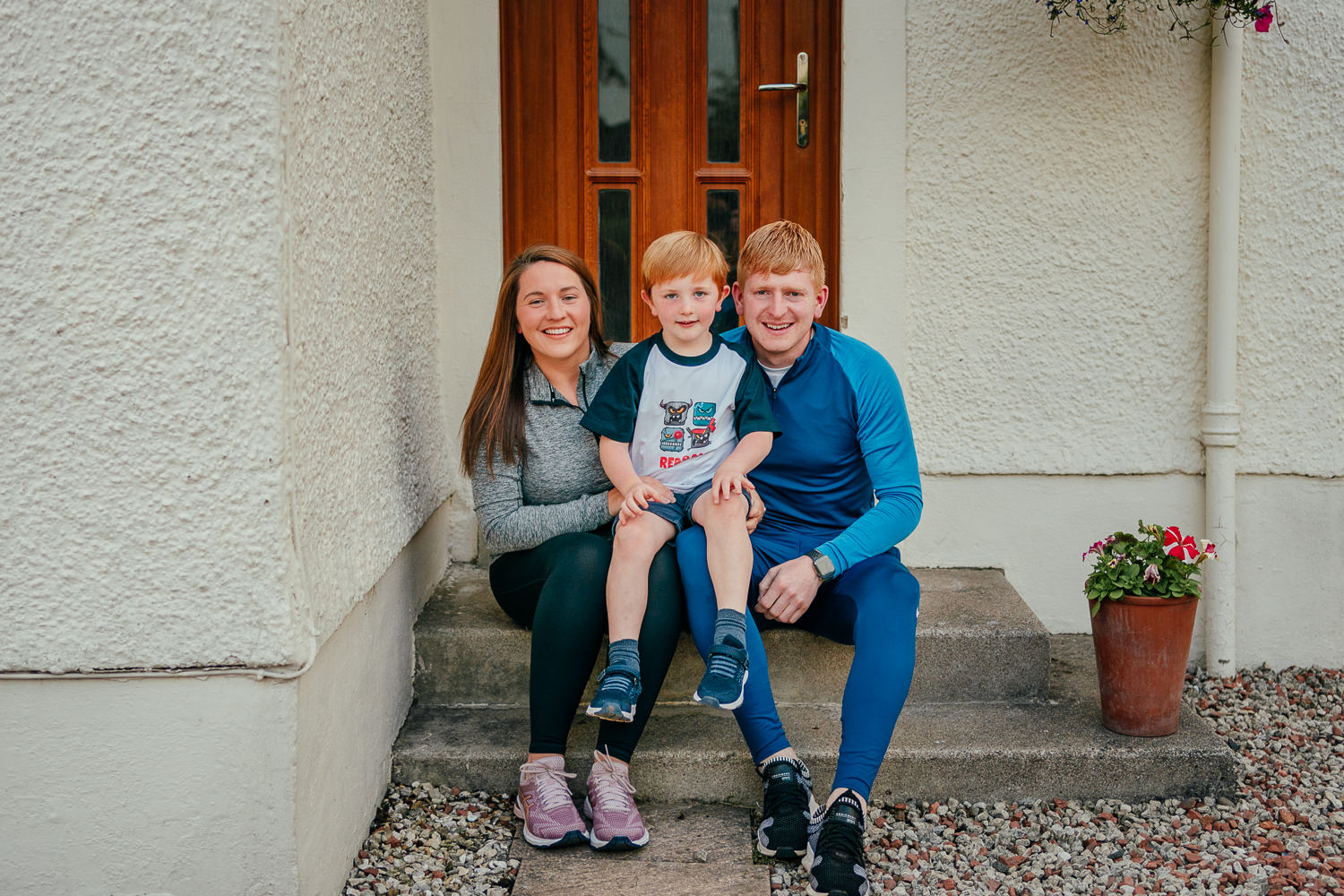 door portraits Glasgow family front door steps mum dad son