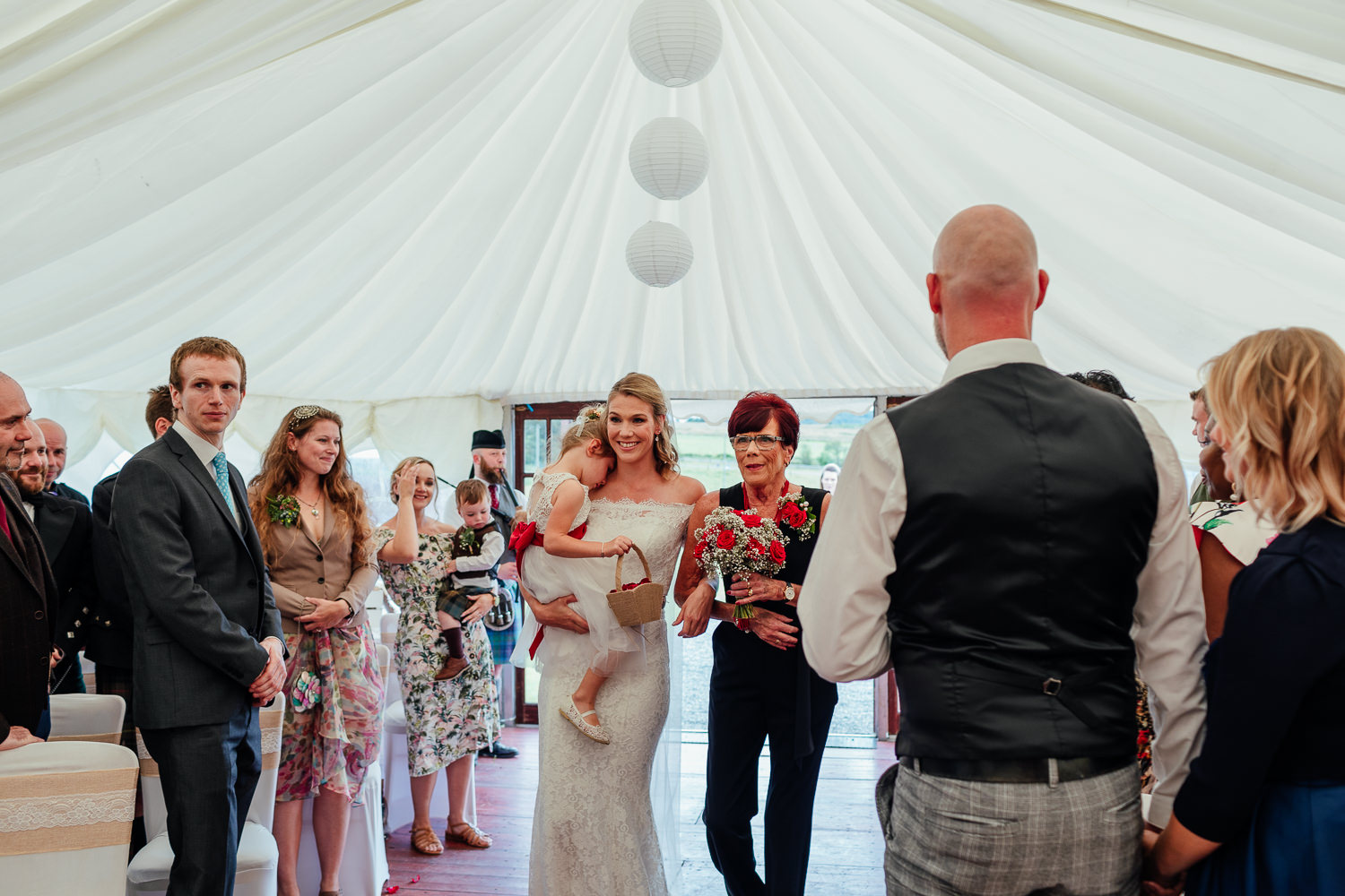 aberdeenshire farm wedding bride walking up aisle with mum