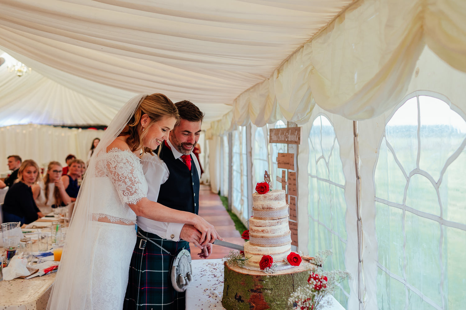 aberdeenshire farm wedding bride groom cutting the cake