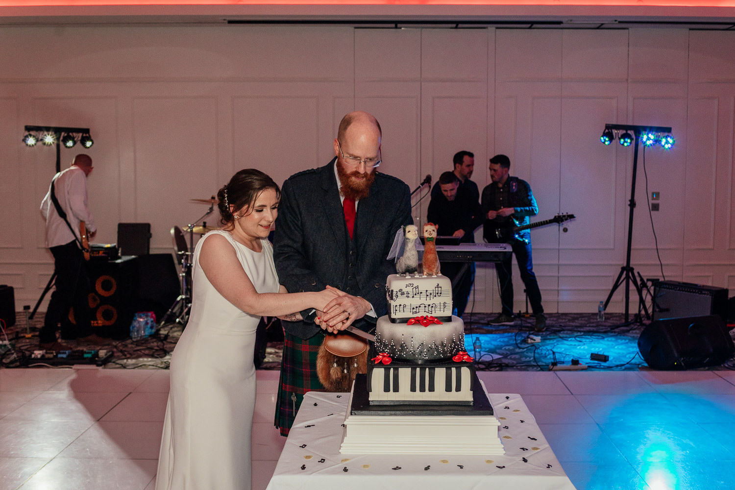 rock music wedding llama rammstein music piano cake bride groom cutting cake chester hotel wedding aberdeen