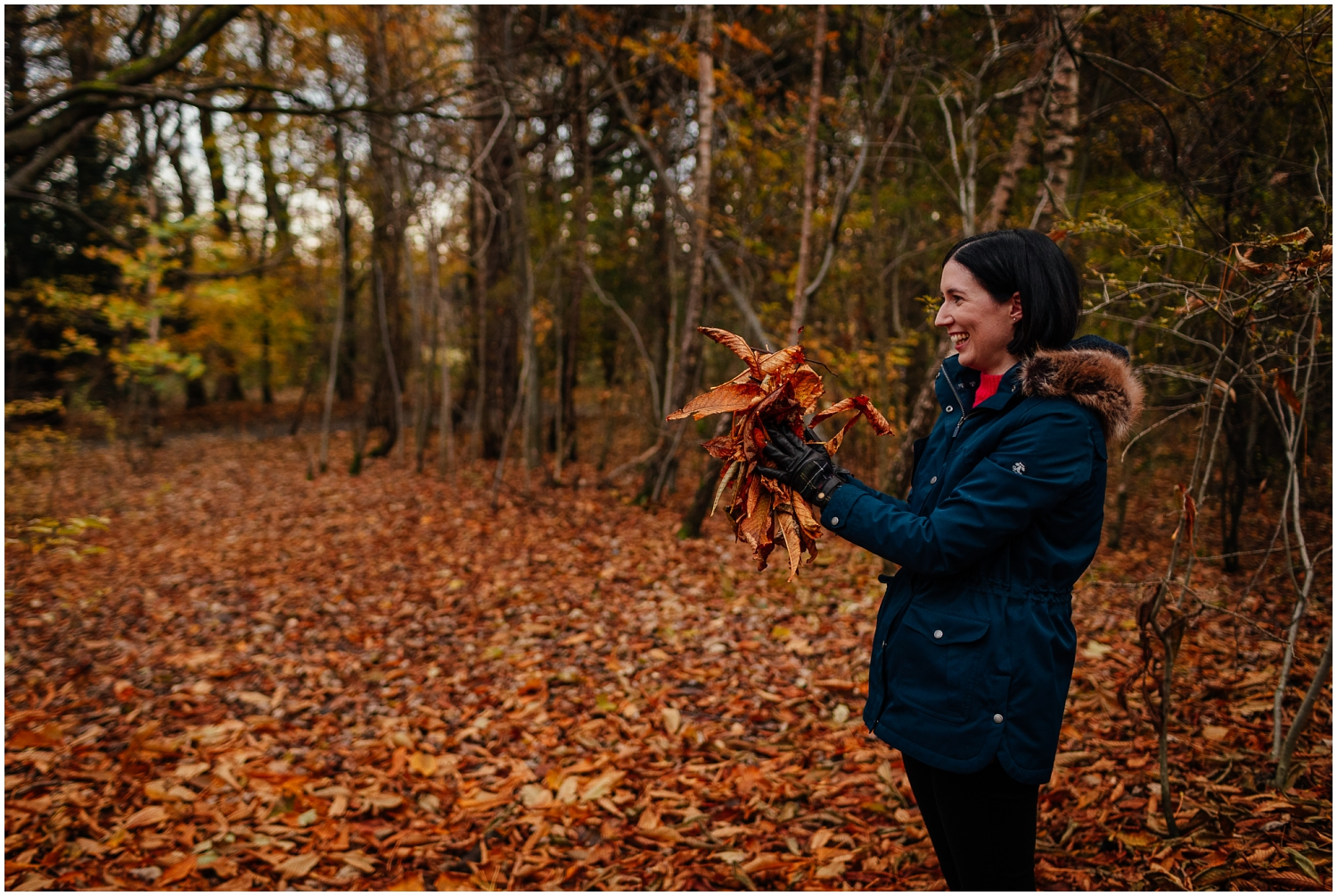 Couple in Pollok Park in Autumn throwing leaves couples shoot engagement shoot