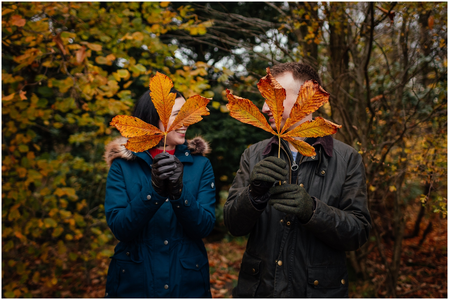 Couple in Pollok Park in Autumn holding leaves couples shoot engagement shoot