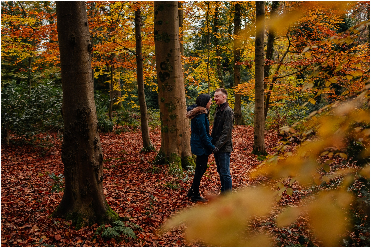 Couple in Pollok Park in Autumn standing laughing