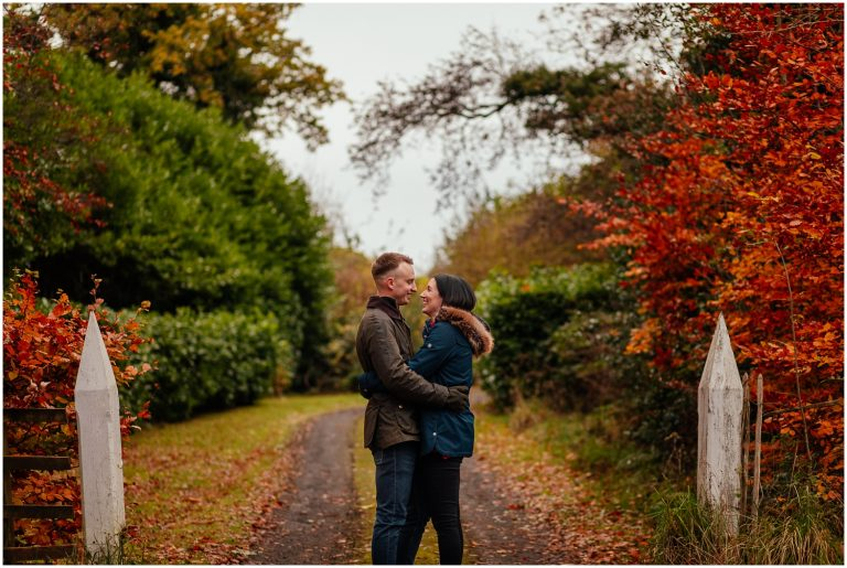 Couple in Pollok Park in Autumn standing laughing couples shoot engagement shoot
