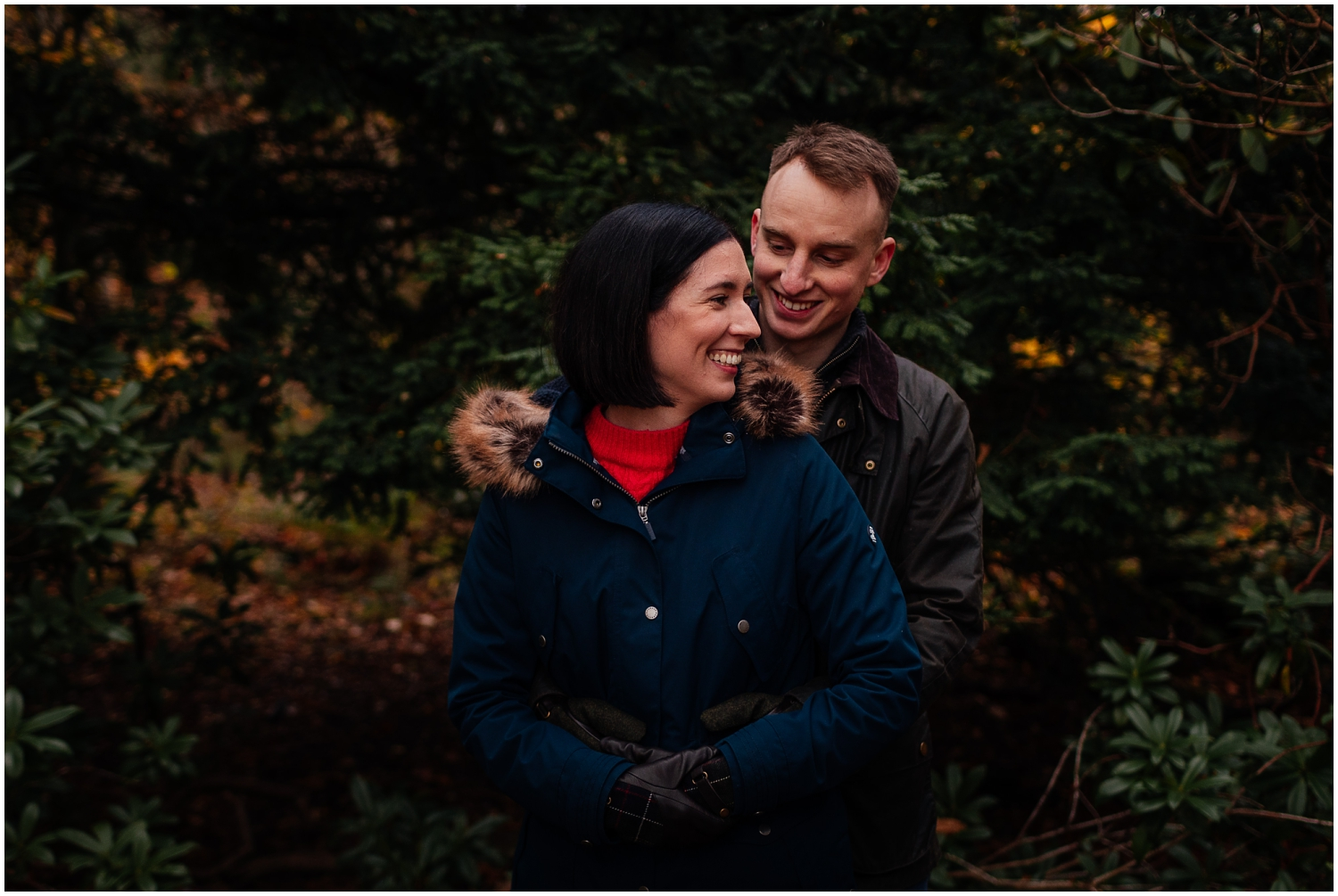 Couple in Pollok Park in Autumn standing smiling couples shoot engagement shoot