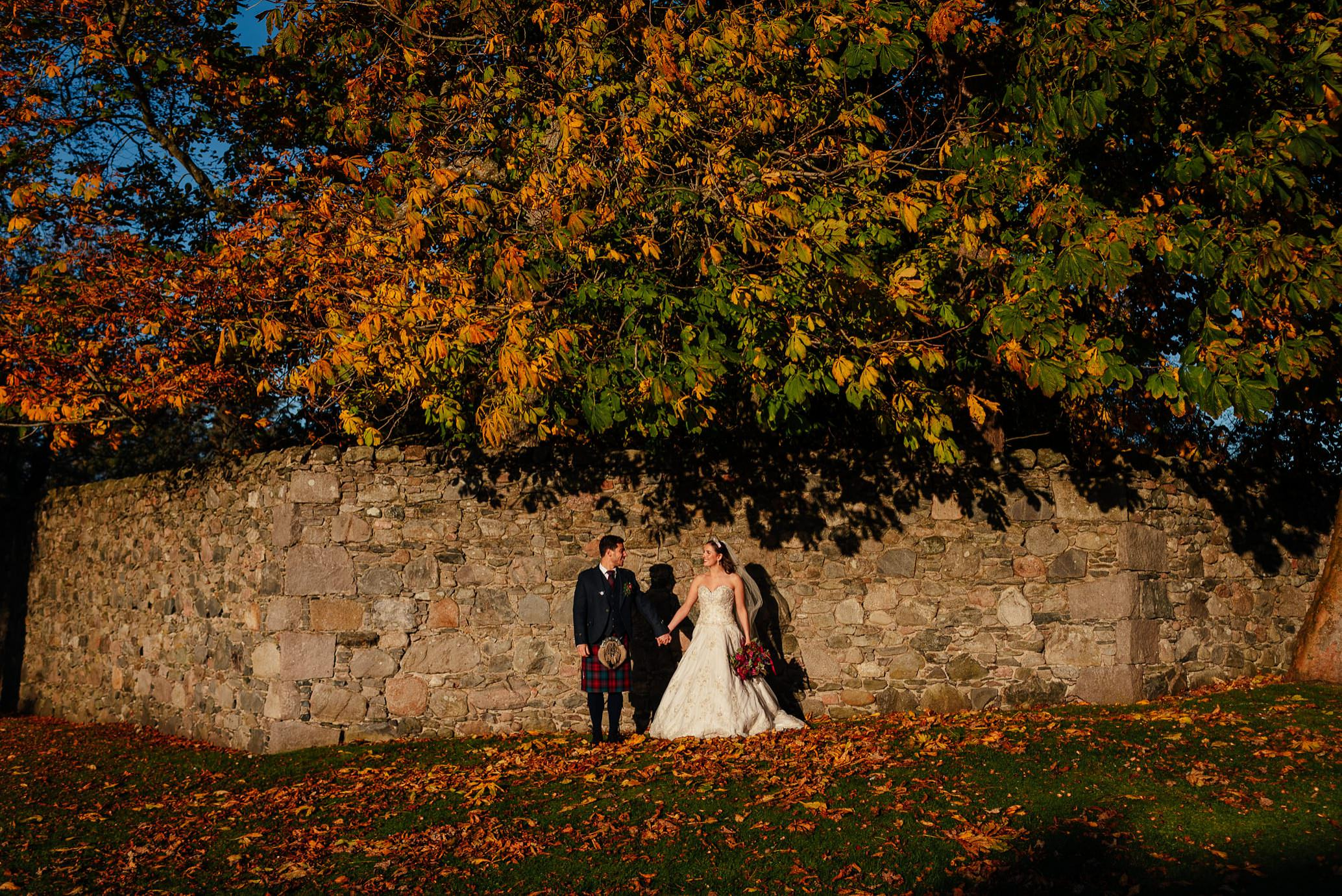 maryculter house hotel aberdeenshire wedding bride groom portraits on grounds in sun october