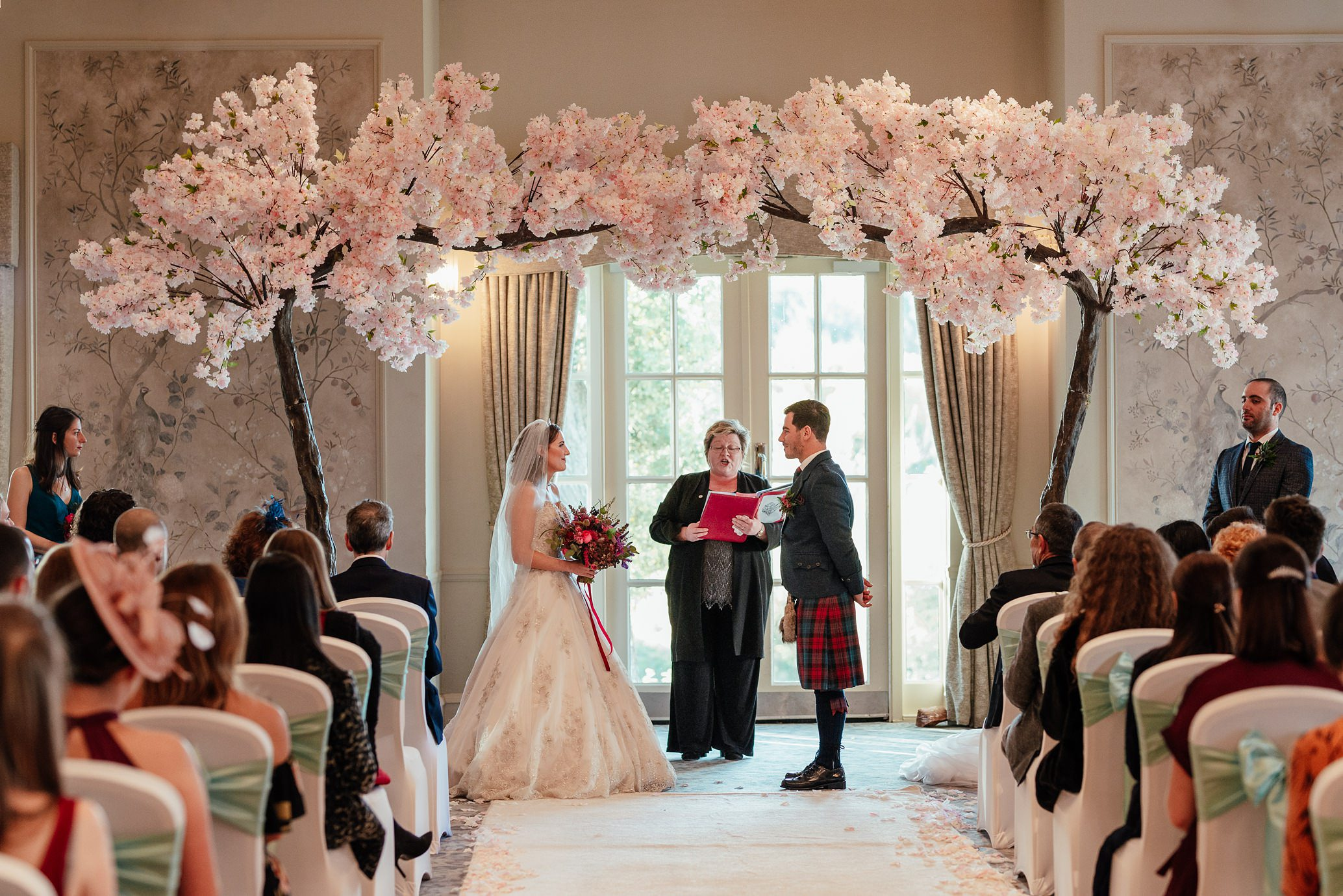 maryculter house hotel aberdeenshire wedding ceremony in ballroom with cherry blossoms