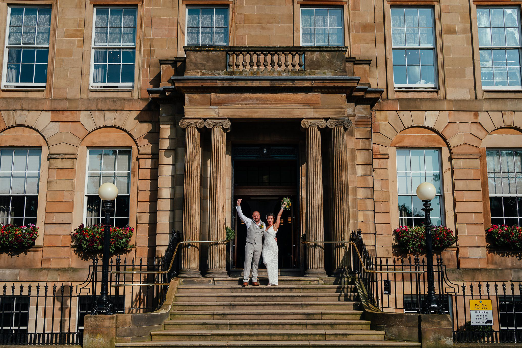 blythswood square glasgow private gardens wedding ceremony bride groom on entrance stairs of blythswood hotel